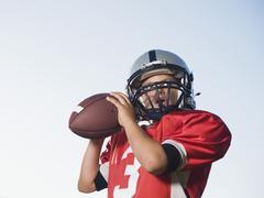 Quarterback preparing to throw football - stock photo