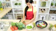 Stock Video Footage of Healthy Asian Chinese Female Red Apron Fresh Organic Produce