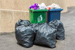 trash bin and black garbage bag - stock photo