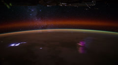 Lightning storms and Milky Way seen from the International Space Station Stock Footage