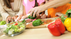 Professional Caucasian Family Group Preparing Dinner Together Stock Footage