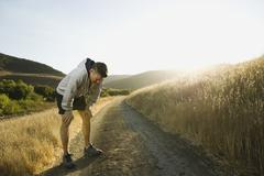 Male jogger resting Stock Photos