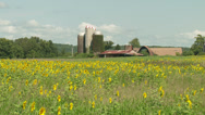 Stock Video Footage of Sunflower Field and Farm 1