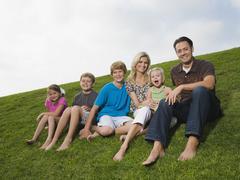 Family sitting on grass Stock Photos