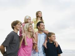 Family portrait at the beach - stock photo