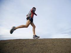 Person running on trail Stock Photos