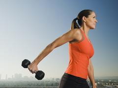 Woman doing weight training Stock Photos