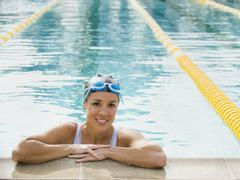 Woman resting after swimming laps - stock photo
