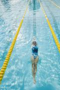 Woman swimming laps - stock photo