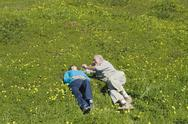 Stock Photo of Couple relaxing in meadow