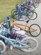 Row of children's bicycles locked up in school yard Stock Photos