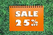 Stock Photo of 25% sale sign on grass background
