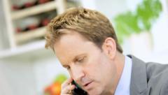 Caucasian Businessman Working Home Wireless Laptop Smart Phone Stock Footage