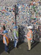 Workers at recycling plant - stock photo
