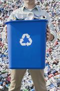 Man holding blue bin Stock Photos