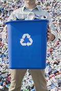 Man holding blue bin - stock photo