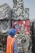 Worker at recycling plant - stock photo
