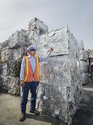 Worker at recycling plant Stock Photos