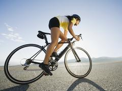 Cyclist road riding Stock Photos