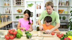 Caucasian Family Preparing Lunch Using Fresh Salad Vegetables Stock Footage