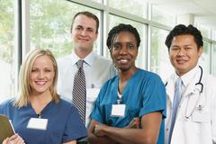 Doctor, hospital manager and two nurses posing for portrait - stock photo