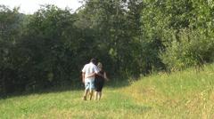 Romantic couple walking grass field sunset happy holding rural beauty woman man  Stock Footage