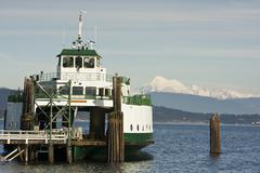 ferry boat and mountain - stock photo