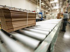 Bundle on conveyor belt Stock Photos