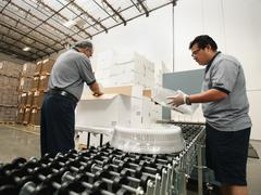 Warehouse workers assembling merchandise - stock photo