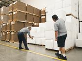 Warehouse workers scanning delivery Stock Photos