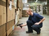Warehouse worker scanning delivery Stock Photos