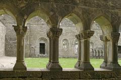 ancient abbey cloisters - stock photo