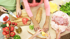 Healthy Caucasian Family Baguette Salad Overhead Hands - stock footage