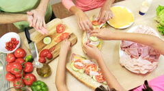 Hands Only Caucasian Family Preparing Lunch - stock footage