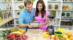 Male Female Wireless Tablet Fresh Fruit Recipe Kitchen Stock Footage