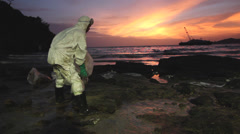 OIL SPILL LANDSCAPE BEAUTIFUL UGLY BEACH CONTRASTS - stock footage