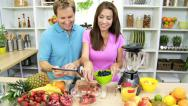 Stock Video Footage of Healthy Caucasian Couple Online Tablet Recipe Fresh Fruit