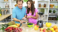 Healthy Caucasian Couple Online Tablet Recipe Fresh Fruit - stock footage