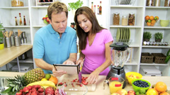 Young Caucasian Couple Wireless Tablet App Organic Fruit - stock footage