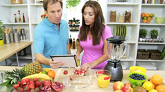 Healthy Caucasian Couple Tablet App Fresh Fruit - stock footage