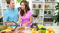 Male Female Wireless Tablet Fresh Fruit Recipe Kitchen Stock Footage