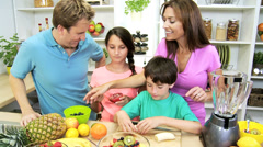 Healthy Caucasian Family Preparing Fresh Organic Fruit Salad Stock Footage