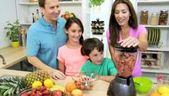 Health Conscious Parents Making Children Organic Fruit Drink - stock footage