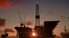Oil rigs in ocean, time lapse sunrise - stock footage