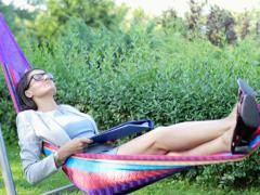 Businesswoman finish work with documents and relax on hammock NTSC Stock Footage