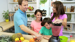 Happy Caucasian Parents Children Blender Fresh Fruit Juice - stock footage