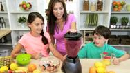 Happy Caucasian Mom Children Blender Fresh Fruit Juice Stock Footage