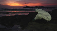 OIL SPILL LANDSCAPE BEAUTIFUL UGLY BEACH CONTRASTS Stock Footage