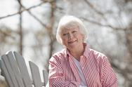 Stock Photo of USA, Virginia, Richmond, portrait of senior woman in adirondack chair