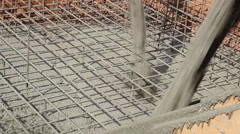 Pouring a concrete foundation on a building site Stock Footage